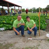 High School agriculture students posing in front of a garden with a new irrigation system.