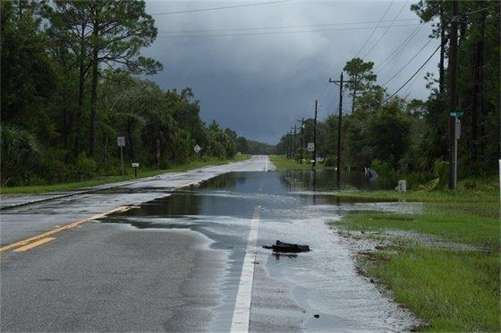 Paved road partly under water in Steinhatchee, Florida.